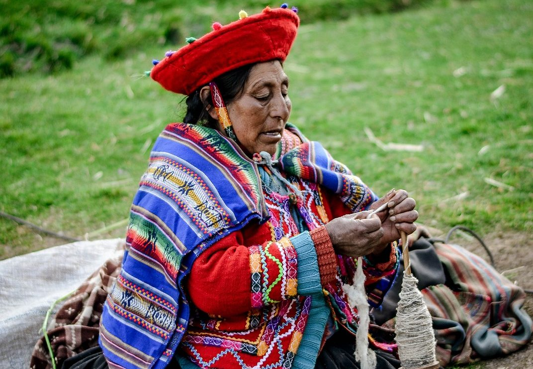 Peruvian lady spinning wool