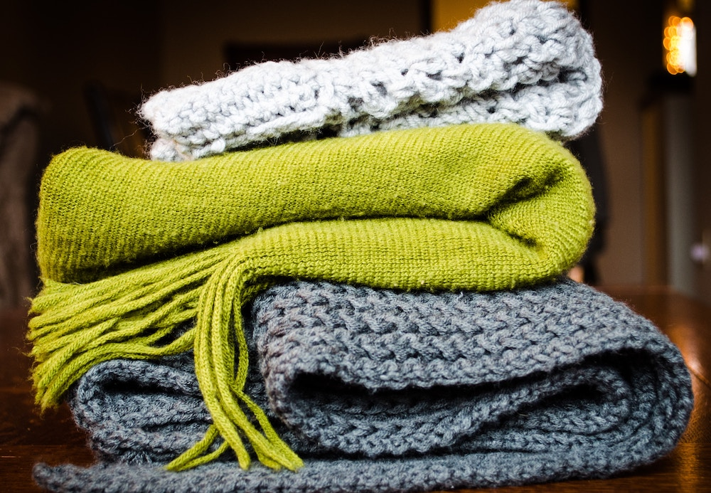 Knitted Scarves in a Pile